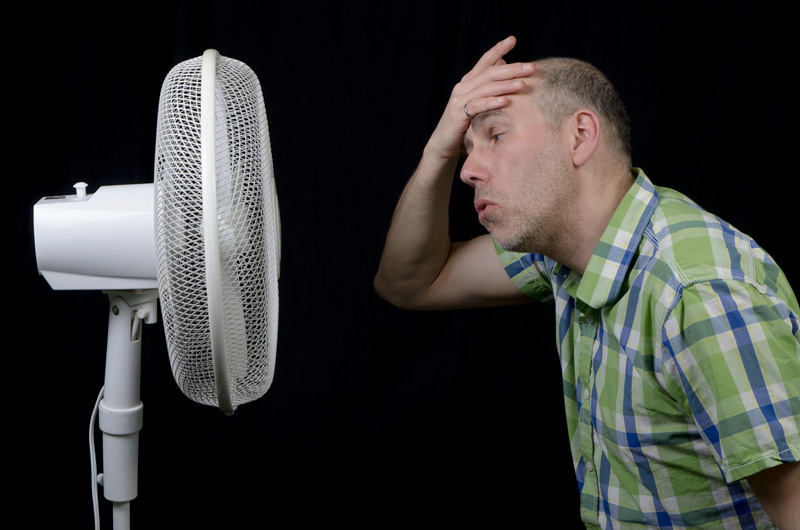 guy in front of fan